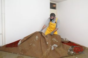 Man Removing Old Carpet In Preparation for a New Carpet Installation